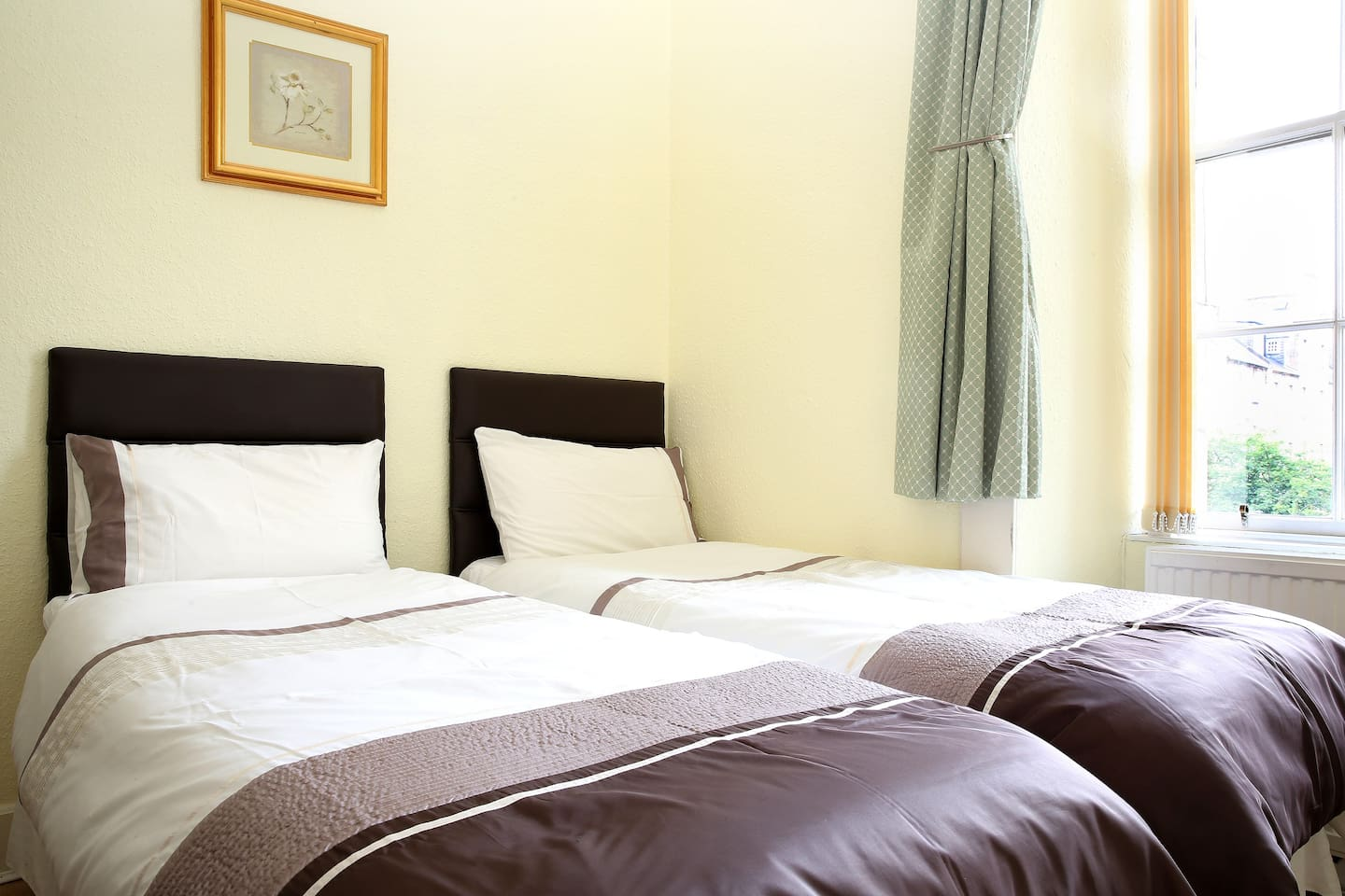 The second bedroom with two single beds or a king size double bed