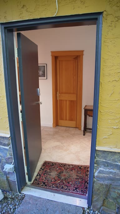Private entrance with foyer and door to bathroom