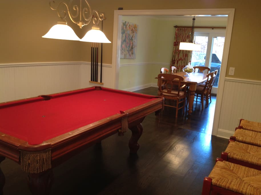 Pool table  in living room for entertainment