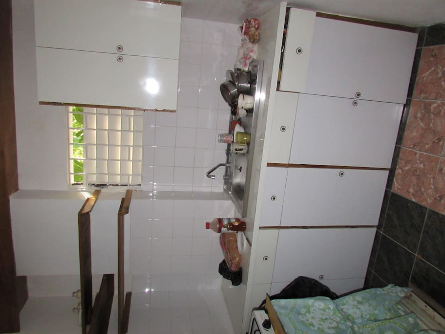 Kitchen with gas stove and small refrigerator