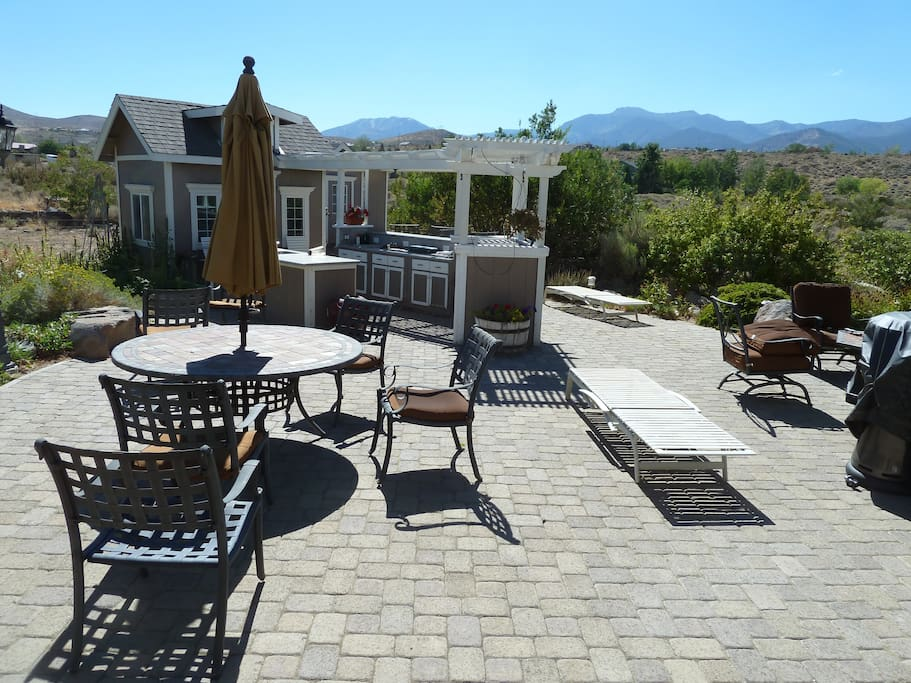 Rear of house with Mt Rose in west back ground. Gas fire pit, BBQ, Bar, chaise lounge chairs, Private settings for your enjoyment. A great place to enjoy the evening sunset, stars as well as a sunny place to relax in the spring, summer and autumn.