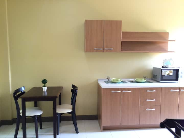 Huge bedroom with kitchen space