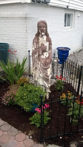 Statue of Jesus originally from Ninfa's (Navigation) Mexican Restaurant, Houston, Tx. MANY movie stars have had their picture take next to this statue, July 2014.