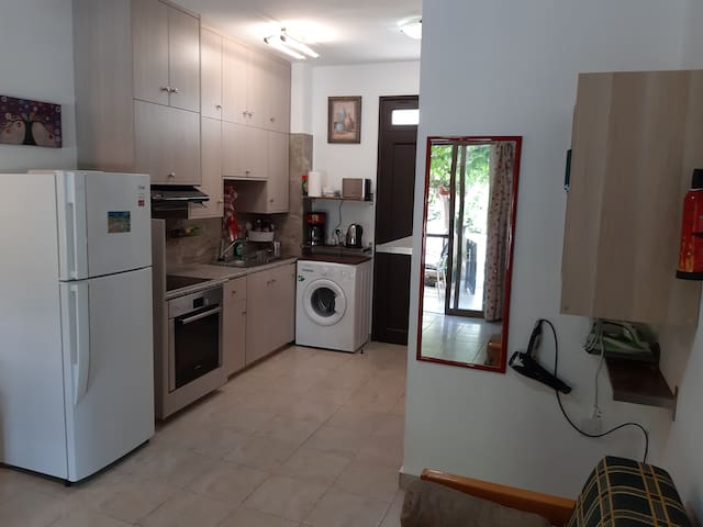 Big fridge __ washing machine __ ceramic cooker _toaster _ coffee machine. ...