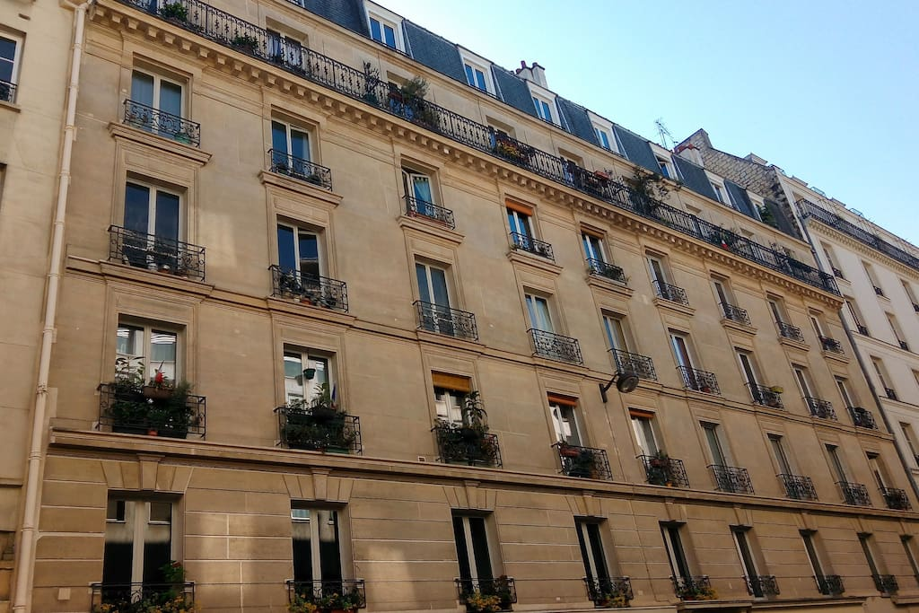 Haussmanien type Building located in front of the police station .