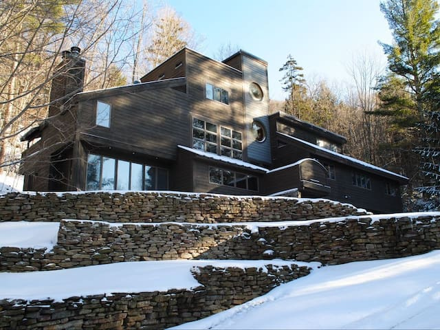 Spacious, modern home in wooded mountain setting.