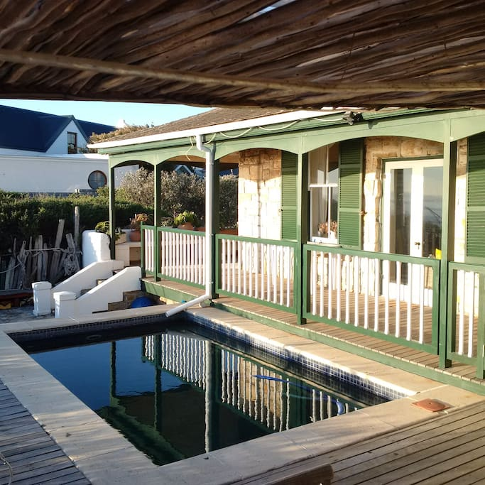 Large deck with plunge pool and covered stoep all around house.