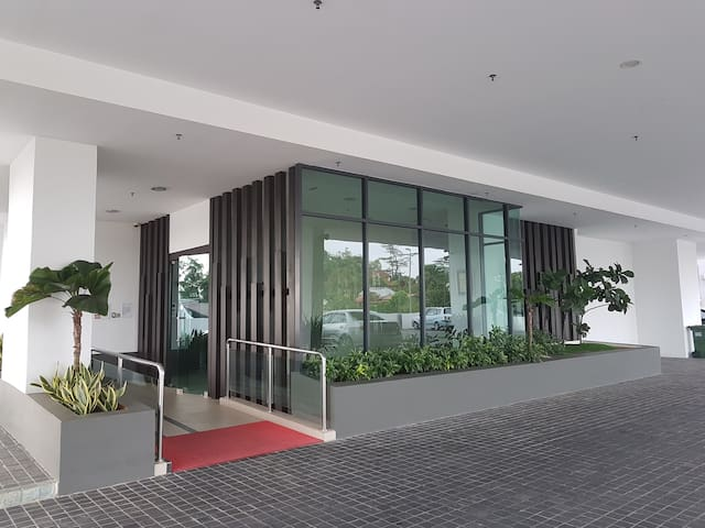 Well Lit Lobby entrance with gentle slope and helping hand railings