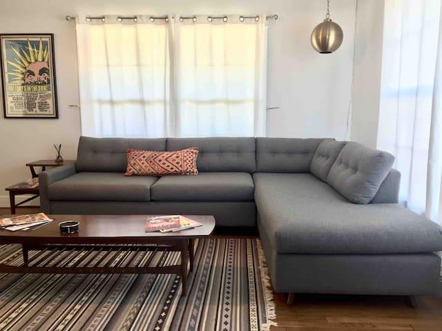 Joybird sectional sleeper sofa.  Queen size memory foam mattress.  Twin size chaise.