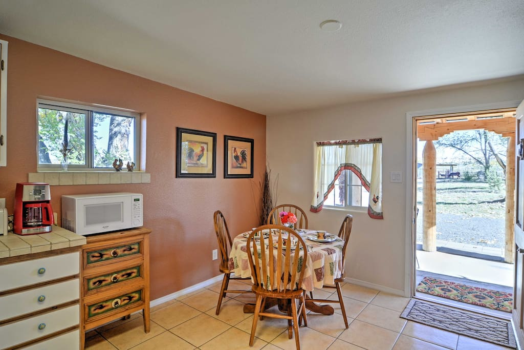 Have a seat around the kitchen table to enjoy your home-cooked meals.