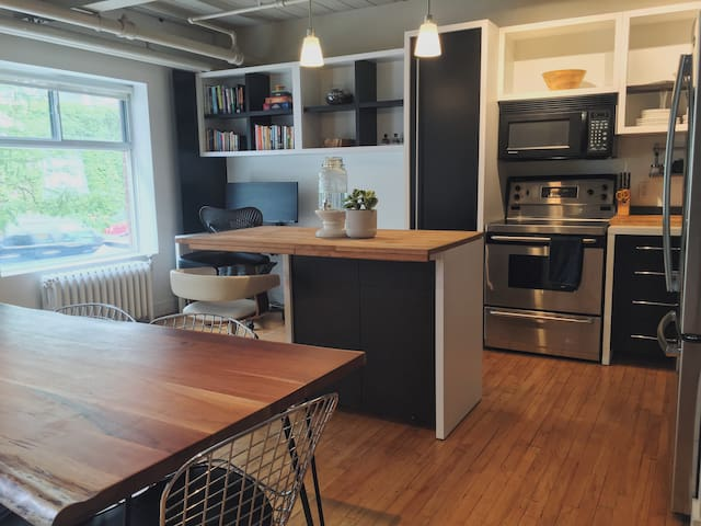 Beautiful Wood Block Island, Dining Area, and Fully Stocked Kitchen for all your Cooking Needs