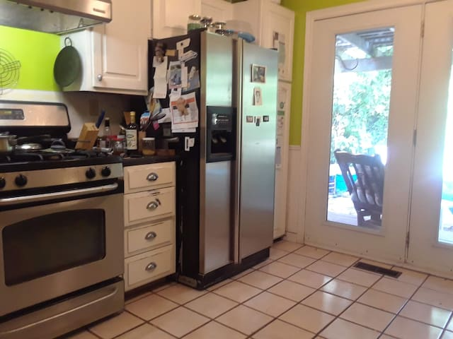 Shared kitchen with view of backyard