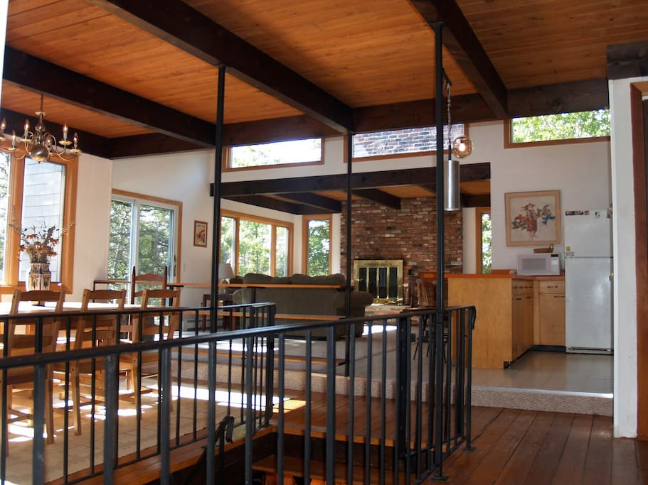 Open space with huge windows, skylights and sliding glass doors to the deck