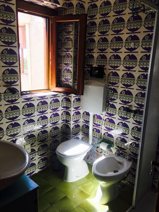 Bathroom with shower, toilet, sink and bidet