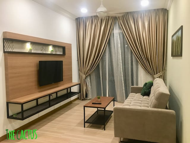 Warmly decorated Living room with smart TV and also sofa bed
