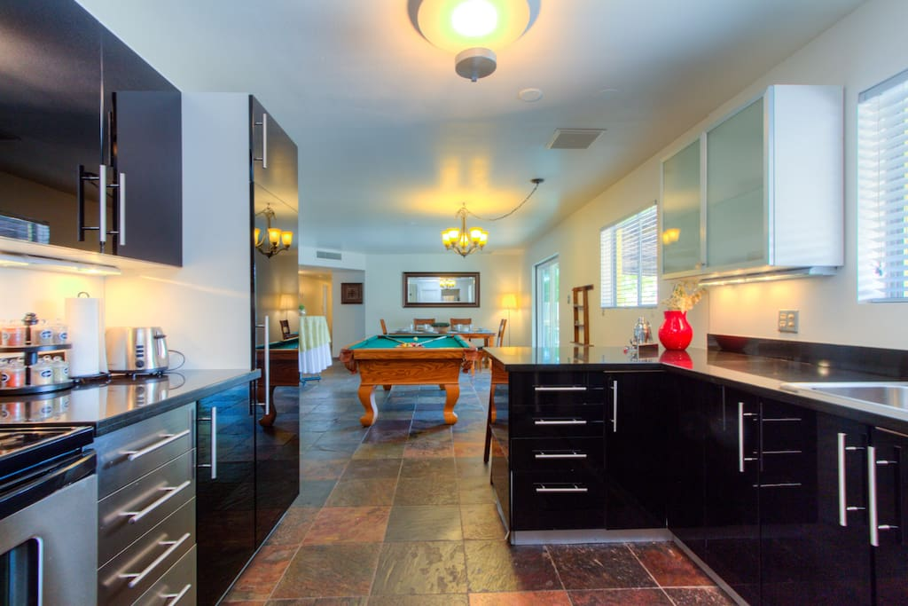 The kitchen opens to the billiard and dining area.