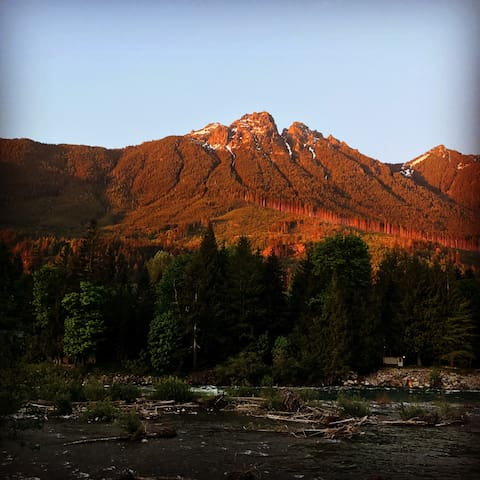Summer 2017  Sun setting behind Mt Palmer and reflecting on Mt Baring turning it orange. Our cabin is surrounded by mountains!