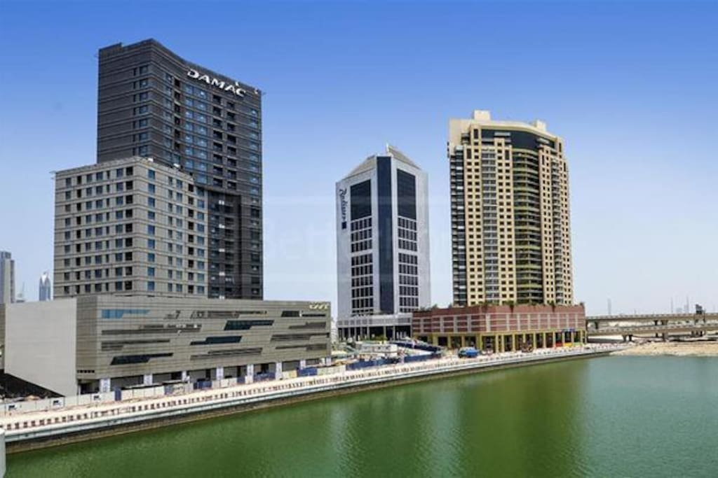 The studio is at the building of the left that says Damac and has full canal view