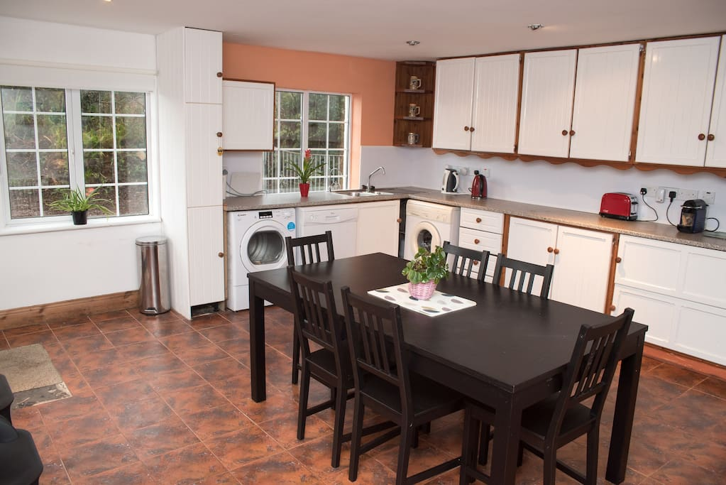 Kitchen - fully equiped with extending table that seats up to 10.