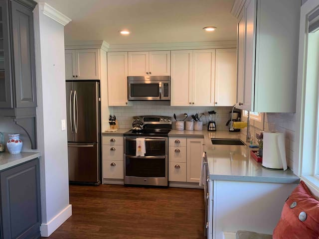 Recently remodeled kitchen with new appliances. Clean and modern with all the necessities for cooking and entertaining.