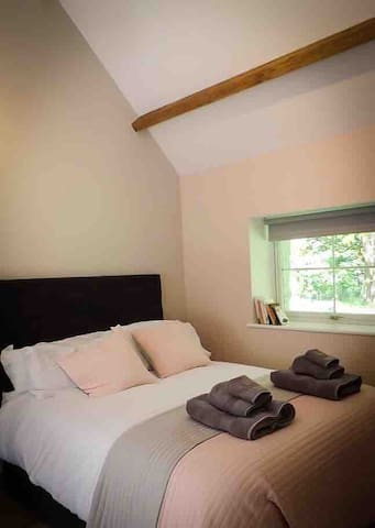 Bedroom area with double bed, tv, Wi-fi and chaise lounge