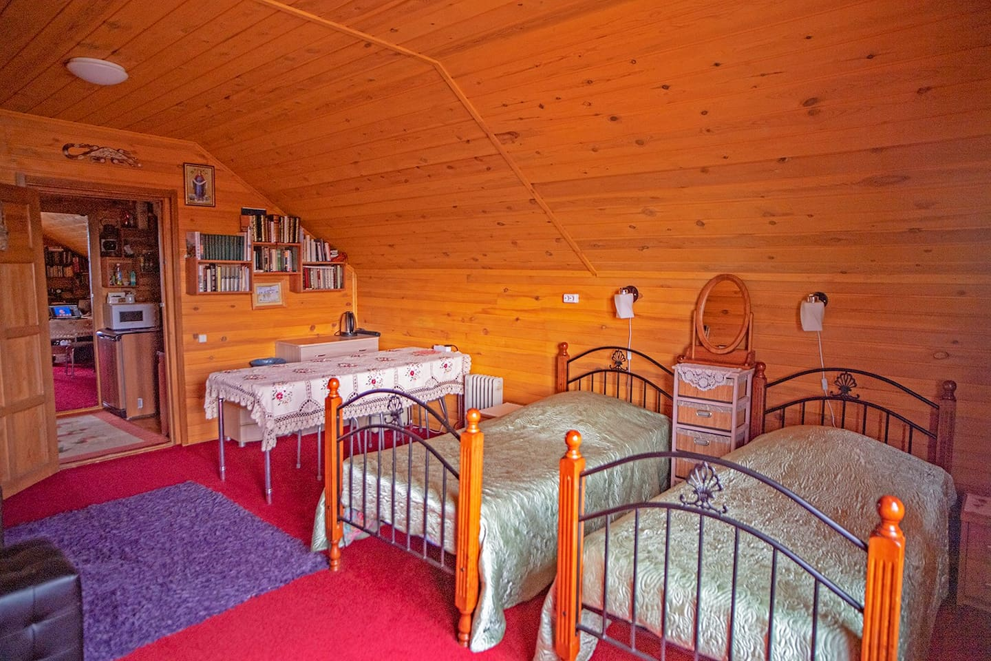 A room  with two single beds and one big sofa may fit 4 people and is an ideal place for a big family than may also rent and neighboring room on the same floor to accommodate 4 more people (8 guests altogether).