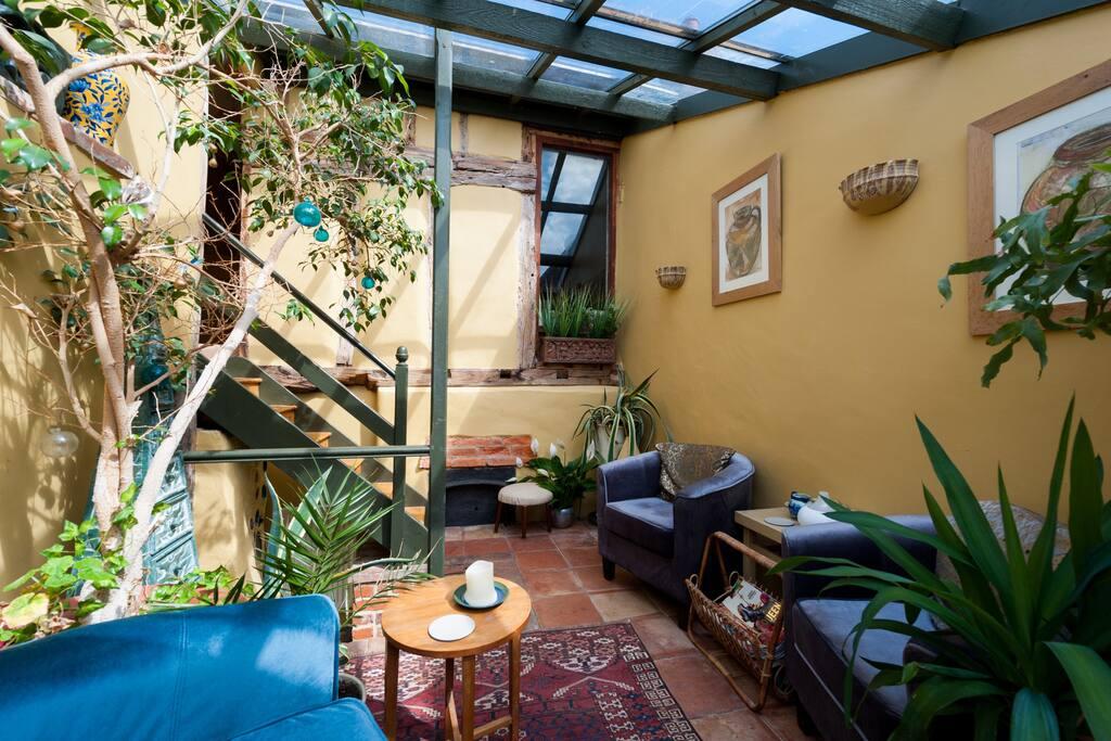 Sun room leading to veranda and upstairs