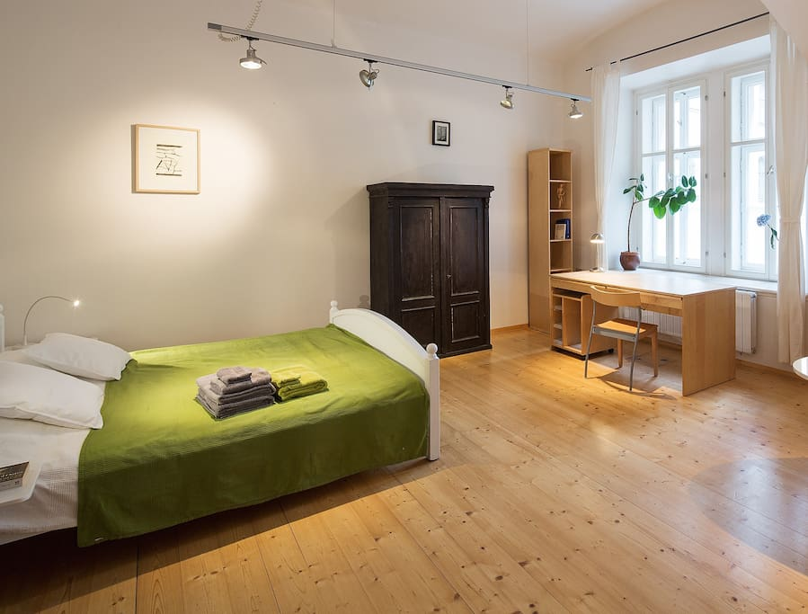 Main room. View of the king-size bed and a working desk