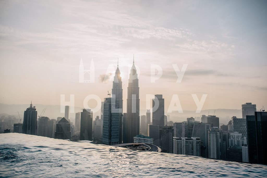 HIGHLIGHT: Sunrise view of KLCC Twin Towers from the infinity sky pool on the Sky Deck