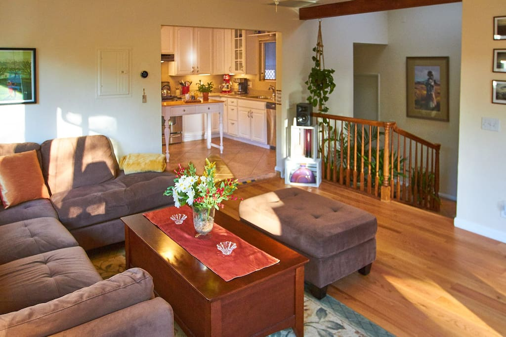 With the adjoining kitchen and atrium, the living room has an expansive feeling