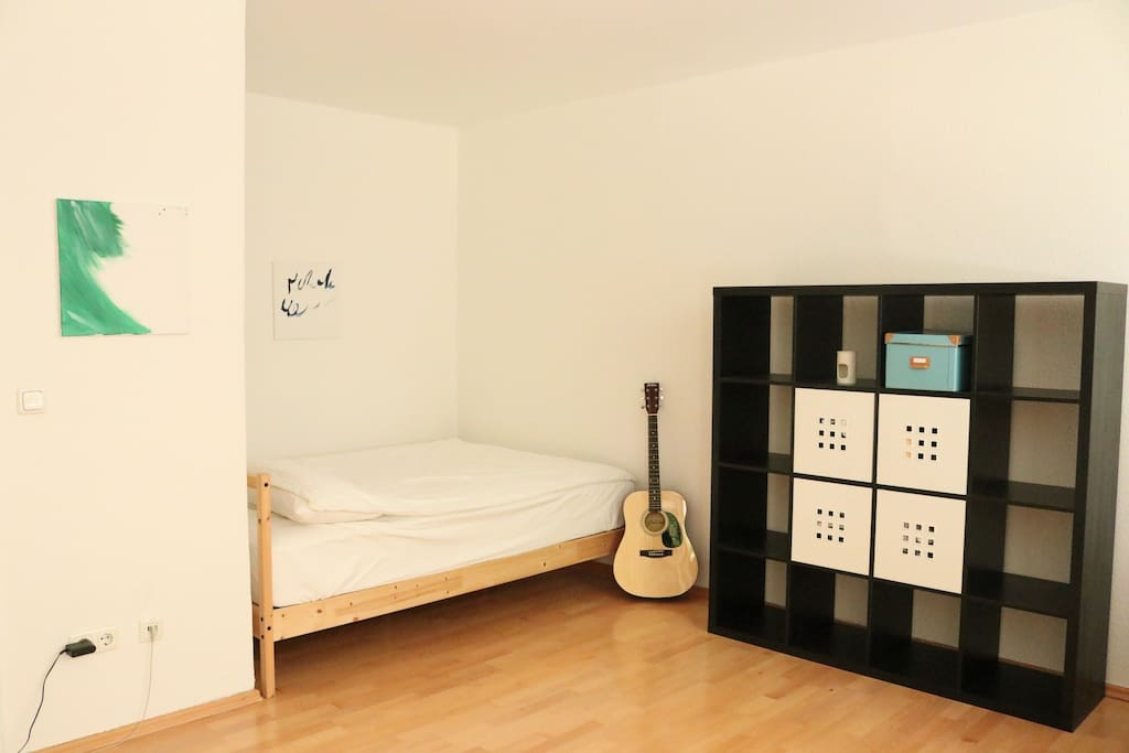 Sleeping nook with queen sized bed (fits two people) - feel free to use the guitar :)