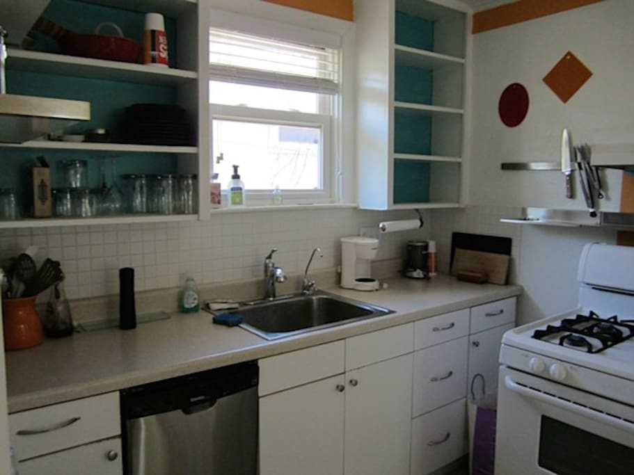 The kitchen may be small, but it has a dishwasher, garbage disposal and gas range.