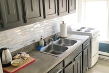 Full kitchen with Concrete countertops