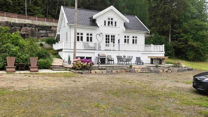Renovated wooden house by the fjord