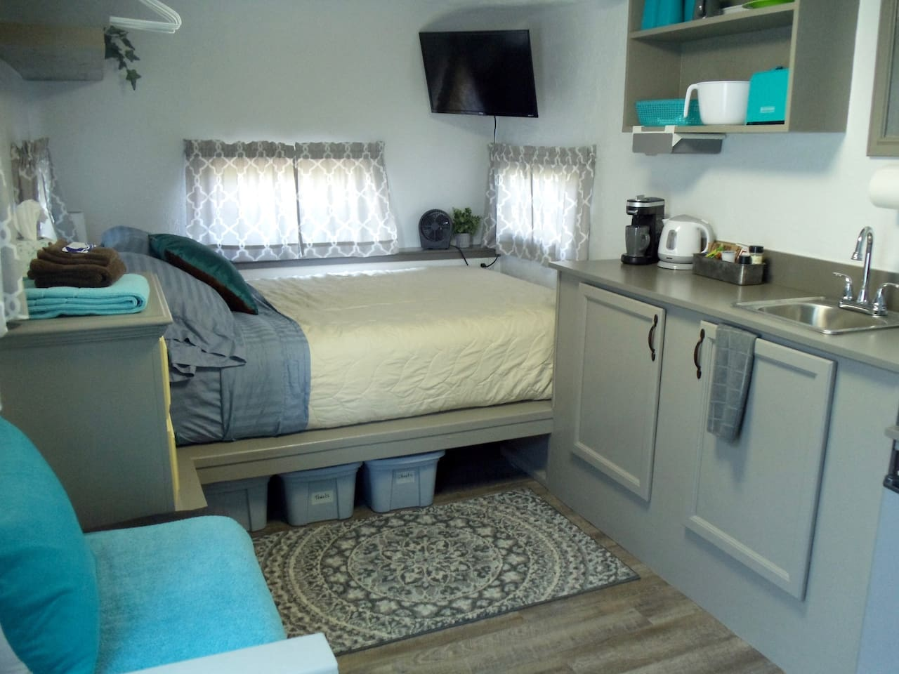 """Welcome to a truly luxurious desert glamping experience! Double size """"real"""" mattress. Kitchenette equipped with mini fridge, microwave, dishes, coffee maker, electric tea kettle, toaster, and hot plate. Internet and TV with streaming video services."""