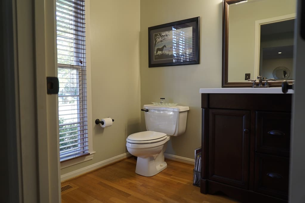 Very spacious half bath on the 1st floor with large mirror for getting ready!