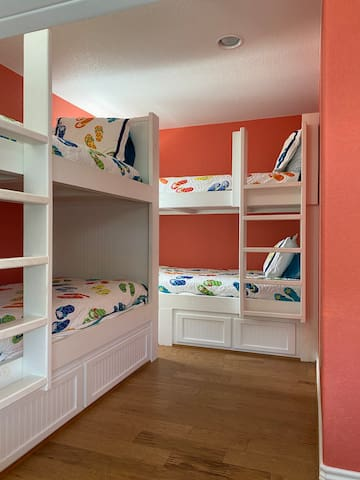 Upstairs bunkroom with 8 built-in twin extra-long bunk beds.  Large enough for adults or kids!