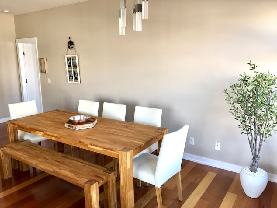 Solid oak table and white leather chairs.