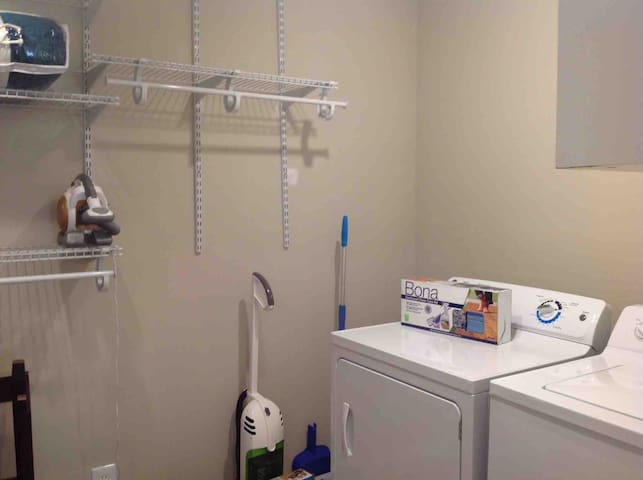 Walk-in closet with triple dresser and washer and dryer. Detergent and fabric softener sheets supplied.