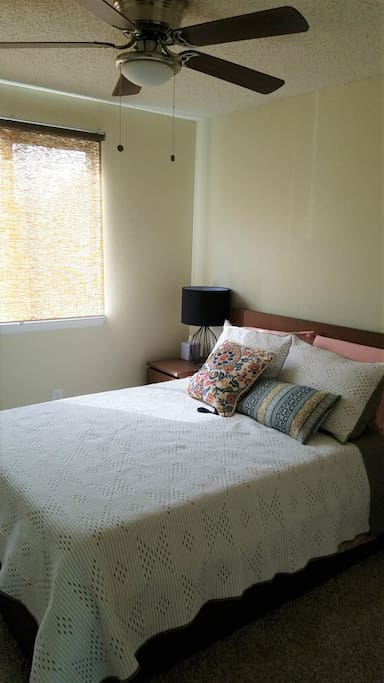 Full size bed with comfortable quilted bedding
