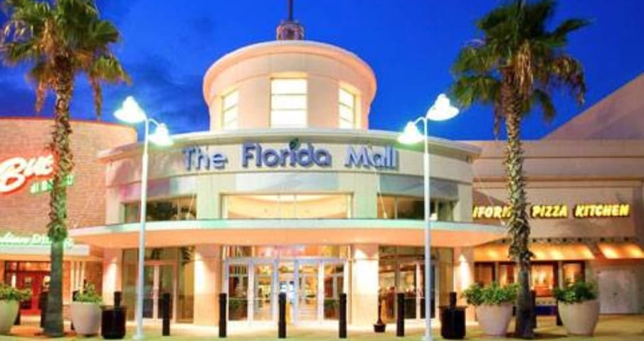 Either a 2 minute drive from the Florida Mall or a short walk :)