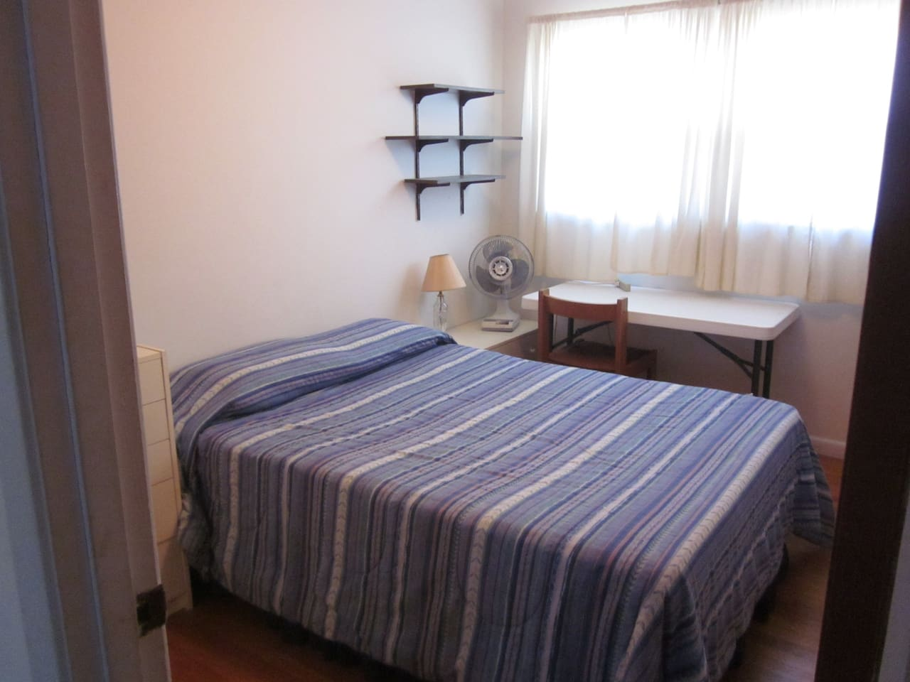 Private guest room -- double bed, table for your laptop or other work, power strip to recharge all your devices, toasty heat in winter and fan in summer for our mild nights.