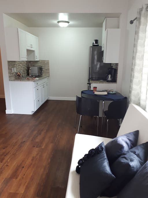 Kitchen area with dining table & seating for 3