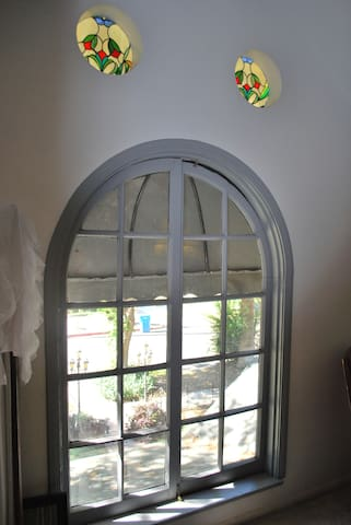 Arched window in suite.