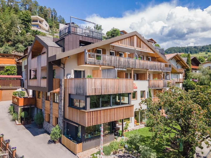 "Charming Apartment ""Sonnleiten Dolomiten Residence - Apt. 3 Sonnenschein"" with Mountain View, Wi-Fi, Pool, Balcony & Garden; Parking Available"