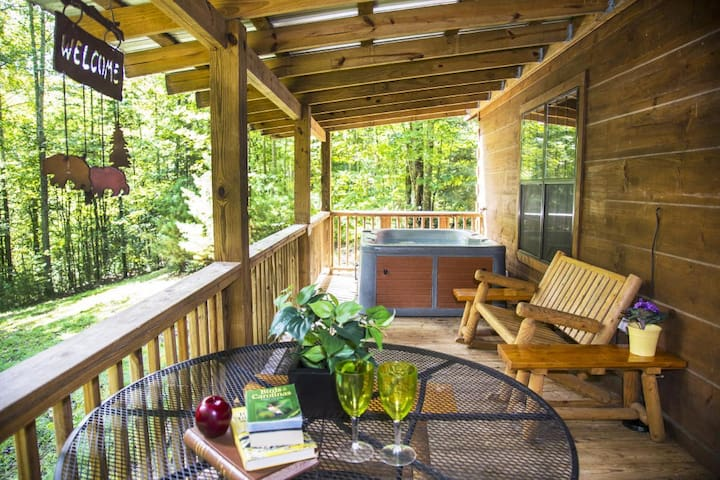 Porch features a hot tub and gas grill.