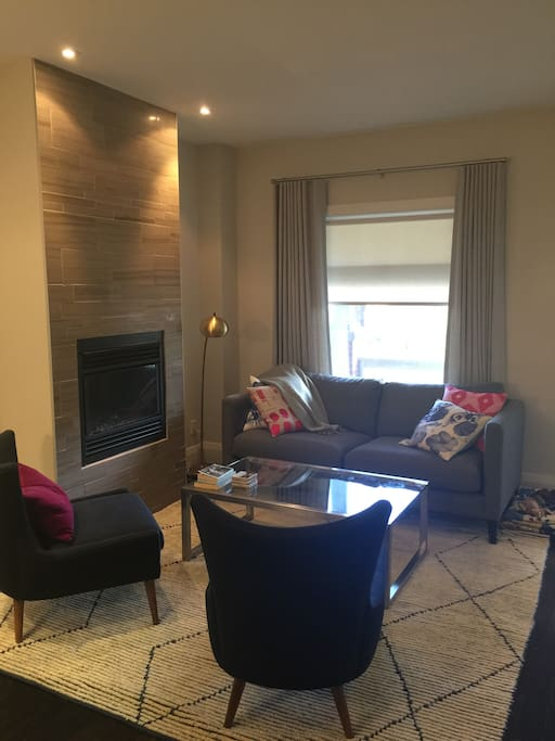 Comfortable living area on main floor, with gas fireplace
