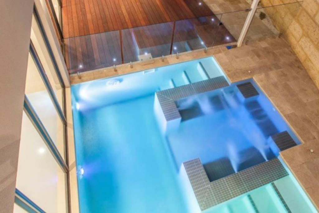 Plunge pool with Jacuzzi and hydrotherapy jet seen from second storey entertainment area