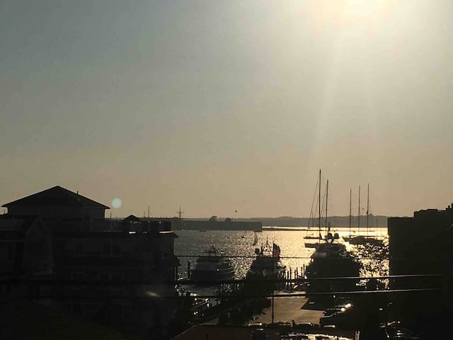 View from rooftop deck of Newport harbor at sunset