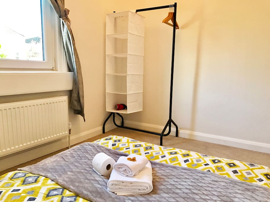 Carpet Floor with Clothes Rail and hairdryer in room + clothes hangers and space for clothes